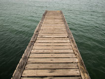 Wooden Bridge from beach to the sea ,closeup Stock Photos