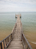 Wooden Bridge from beach to the sea Stock Photos