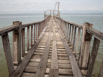 Wooden Bridge from beach to the sea Royalty Free Stock Photo