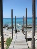 Wooden bridge on the beach stock photo