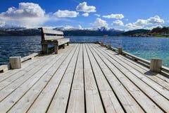 Wooden bridge with bench. Norheimsund beach view Stock Photo