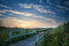 Wooden bridge for bikes at sunrise Royalty Free Stock Images