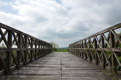 Wooden Bridge, Blue Sky and Clouds Royalty Free Stock Images