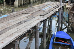Wooden bridge and boat Royalty Free Stock Photography
