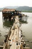 Wooden bridge boat pier rural sea shore Royalty Free Stock Photos