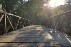 Wooden bridge centered Stock Photo