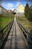 Wooden bridge in the city. Wooden bridge over the river Dobličica in place Crnomelj Stock Photos