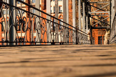 Wooden bridge in the city on a sunny day Royalty Free Stock Photo