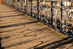 Wooden bridge in the city on a sunny day Royalty Free Stock Images