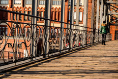 Wooden bridge in the city on a sunny day Royalty Free Stock Image