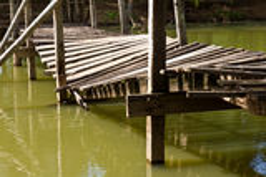 Wooden bridge collapsed Stock Photo
