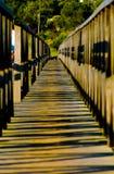 Wooden Bridge - Pedestrian Walkway - Perspective. Wooden bridge that connect Quinta do Lago or Lake Resort and Gigi Beach. Protected area Ria Formosa, Algarve Royalty Free Stock Photo
