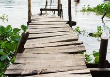 Wooden bridge connecting Champa village to river in Mekong delta, Vietnam.  Royalty Free Stock Images