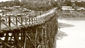 Wooden bridge connects two sides of river Royalty Free Stock Image