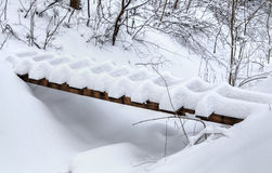 Wooden bridge covered with snow Royalty Free Stock Photo