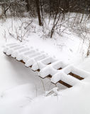 Wooden bridge covered with snow Stock Photography