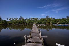 Wooden bridge. Cross the river with blue sky as a background Stock Photo