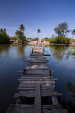 Wooden bridge. Cross the river with blue sky as a background Royalty Free Stock Images
