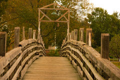 The Wooden Bridge. A wooden bridge that crosses Spring Lake, in Spring Lake New Jersey Royalty Free Stock Photo