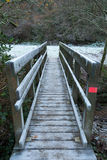 Wooden bridge crossing a river Stock Images