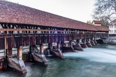 A wooden bridge crossing the river Aare in Thun  early in the morning - 3. A wooden bridge crossing the river Aare in Thun  early in the morning royalty free stock photo