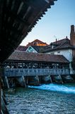 A wooden bridge crossing the river Aare in Thun early in the morning - 1. A wooden bridge crossing the river Aare in Thun early in the morning royalty free stock image
