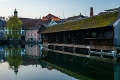 A wooden bridge crossing the river Aare in Thun early in the morning - 2. A wooden bridge crossing the river Aare in Thun early in the morning royalty free stock photo
