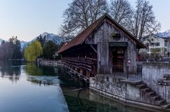 A wooden bridge crossing the river Aare in Thun with the Jungfrau and Eiger mountains in the background early in the morning - 3. A wooden bridge crossing the stock photography