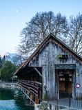 A wooden bridge crossing the river Aare in Thun with the Jungfrau and Eiger mountains in the background early in the morning - 2. A wooden bridge crossing the stock photography