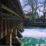 A wooden bridge crossing the river Aare in Thun in spring, shot with analogue film photography. 1 stock photo