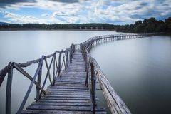Wooden bridge crossover reservoir southern of Thailand Royalty Free Stock Image