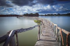 Wooden bridge crossover reservoir southern of Thailand Stock Photos