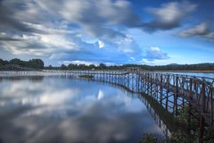 Wooden bridge crossover reservoir southern of Thailand Stock Photo