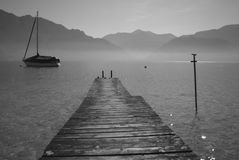 Wooden bridge - early morning on the lake Stock Photos