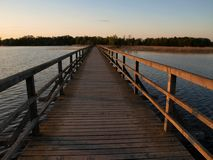 Wooden bridge evening view Royalty Free Stock Image