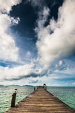 Wooden bridge extending into the sea Royalty Free Stock Image