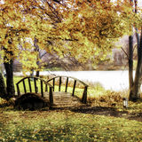 Wooden bridge in the Fall. Very scenic small wooden bridge, wet foggy overcast day, fall foliage, shot using the brenzier method to give a shallow depth of field Royalty Free Stock Photos