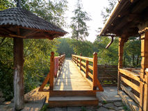 Wooden bridge on first sunrays at morning Royalty Free Stock Image