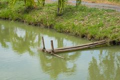 Wooden bridge in fish farm pool. Stock Photos