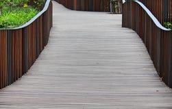 Wooden bridge in the flower garden stock photos