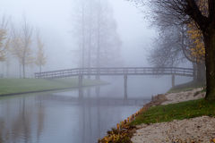 Wooden bridge in fog Royalty Free Stock Photos