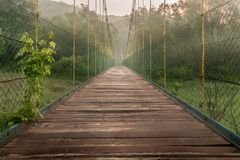 Wooden bridge in a fog stock images