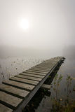 Wooden bridge in foggy scenery Royalty Free Stock Photography