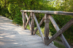 Wooden bridge In forest. Background for design Royalty Free Stock Photo