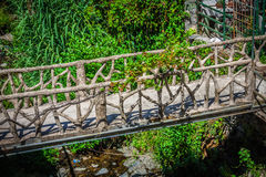 Wooden bridge in the forest at the river Stock Photos
