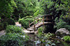 Wooden Bridge in a Garden. A wooden bridge across a stream in the Zilker Botanical Gardens in Austin, Texas Stock Photos