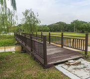 Wooden bridge. In the garden at the river Stock Photography