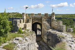 Wooden bridge and Gate of ancient fortress. Royalty Free Stock Photos
