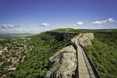Wooden bridge and gate of ancient fortress. Stock Image