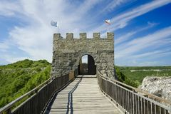 Wooden bridge and Gate of ancient fortress. Stock Photo